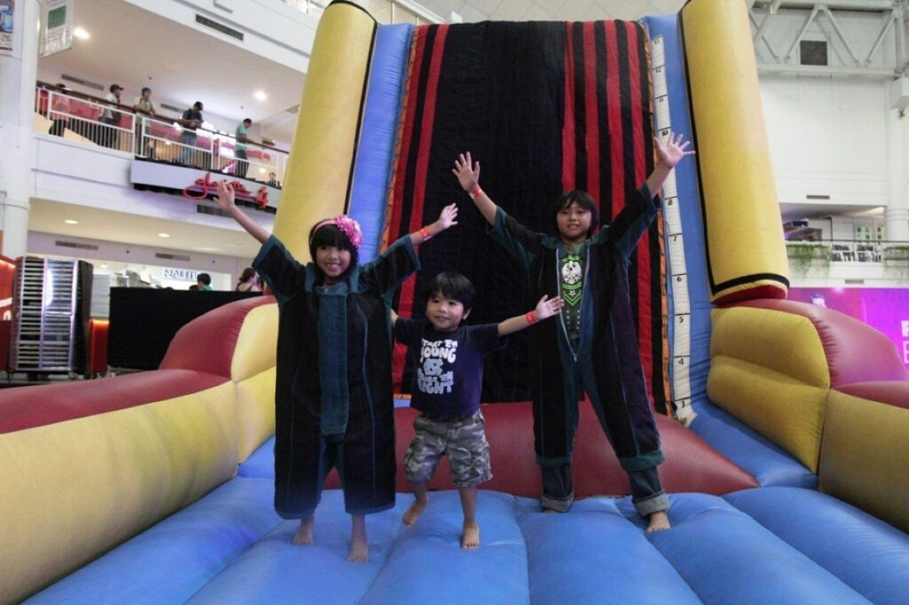 Kids of all ages had their share of thrills at the Summer Fair's Velcro wall where guests young and old showed off their fanciest and funniest poses.
